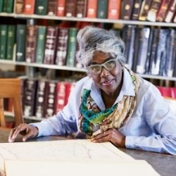 older lady researching in a library
