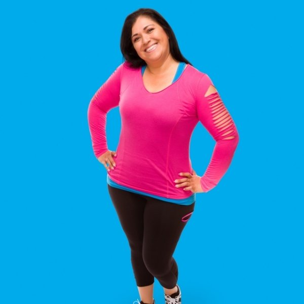 middle aged latin woman in exercise clothes